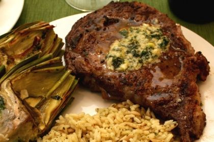 Grilled Rib Eye Steak with Herb Butter Sauce