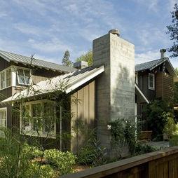 Awning Windows, grey metal roof, dark brown house, off white trim