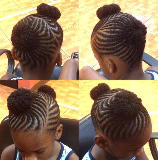 cornrows and two buns...love this hairstyle! well done. :0)