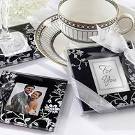 Black and white wedding ideas. Impress your guests with stunning glass coasters for their wedding favor, showcasing a white floral motif on jet-black background. #weddingfavors #weddings #exclusivelyweddings