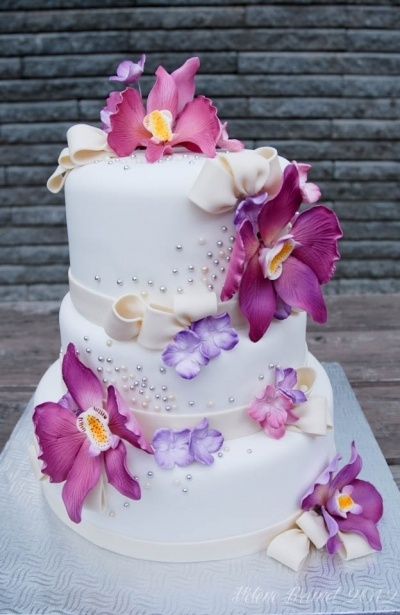 Purple orchids wedding cake By buttercreamfantaisies on CakeCentral.com