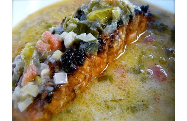 ... grilled marinated salmon in a green onion, coconut and ginger broth