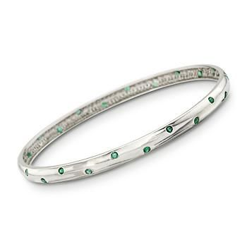 Trendy slip-on bangle bracelet is spangled with bezel-set emerald polka dots. >>Click on the sterling silver bangle bracelet to see more like this. #bangle #bracelet #polkadot #silver