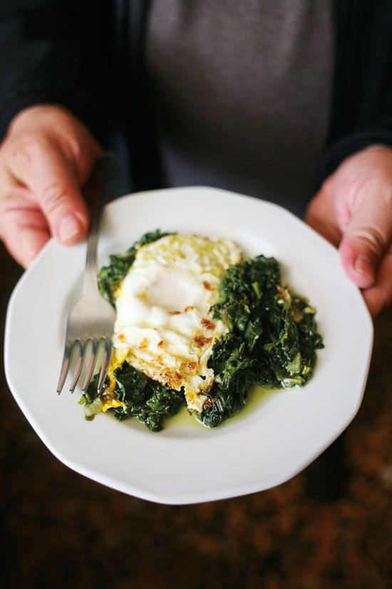 ... this dish combines luscious fried eggs with pleasingly bitter greens
