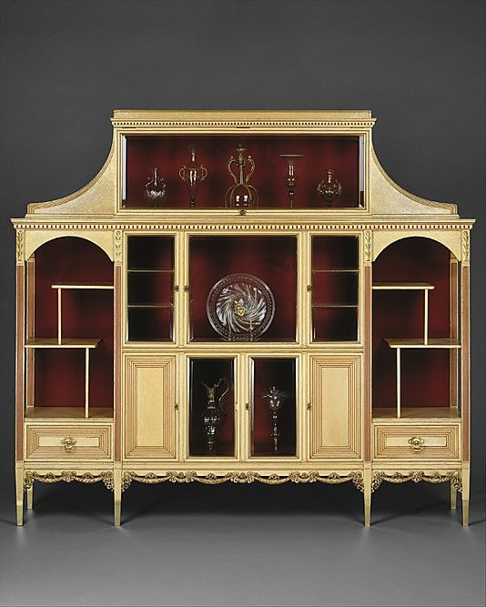 Cabinet  Attributed to Herter Brothers (1864–1906)  Date: ca. 1883 Geography: Mid-Atlantic, New York City, New York, United States Culture: American Medium: Maple, with painted and gilded surface, bevelled glass, silk velvet, brass