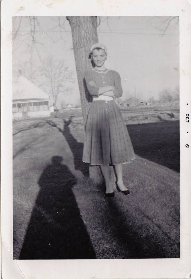 vintage photo boy dressed as girl poses by tree amp shadow 1961