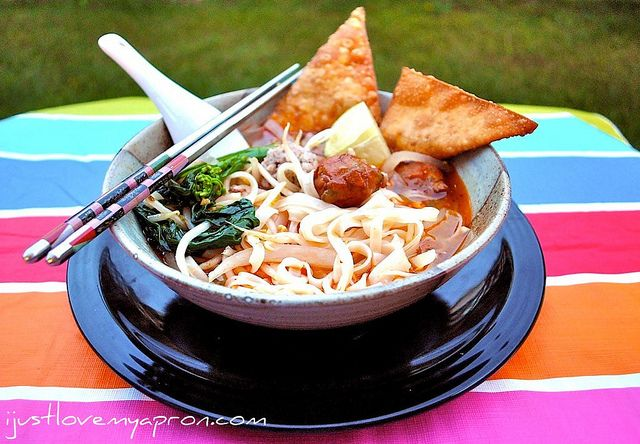 Street Food Tom Yum Noodle Soup With Crispy Wontons