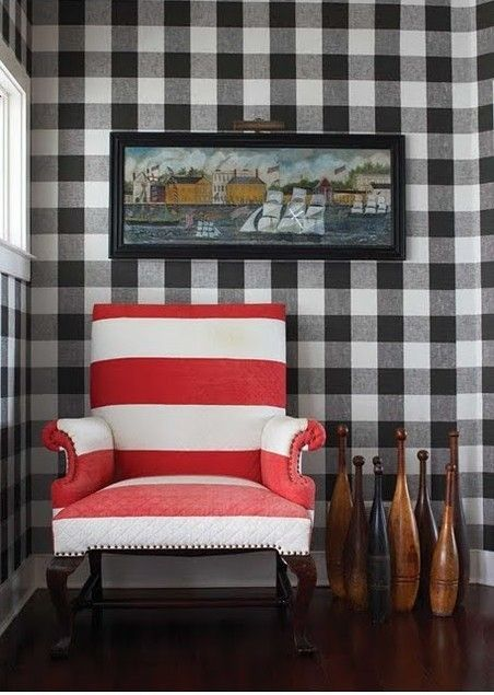 Contrast -wide red  white stripes juxstaposed next to large black  white buffalo checked wall paper.