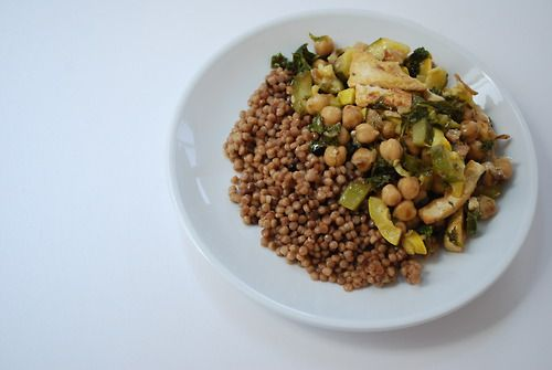 Lemony chickpea stir fry with kale, zucchini, squash and tofu, served ...