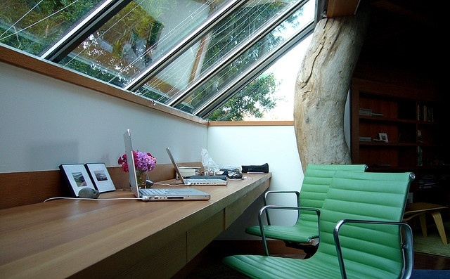 great windows and use of space. it's a perfect spot for a desk/office area.  those chairs are also fantastic.