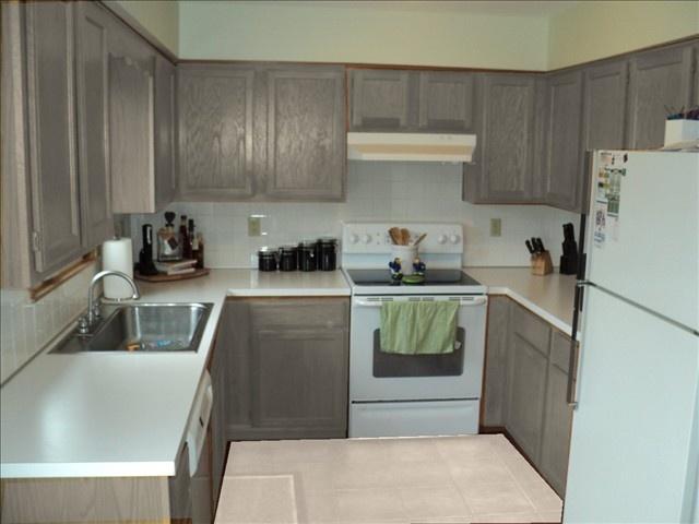 grey kitchen cabinets white appliances