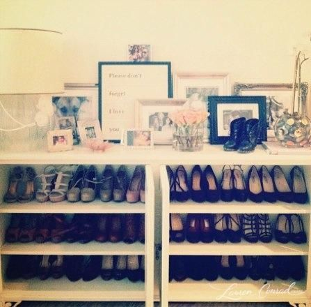 Low bookcases for shoe storage with lamps and picture frames to top it off.