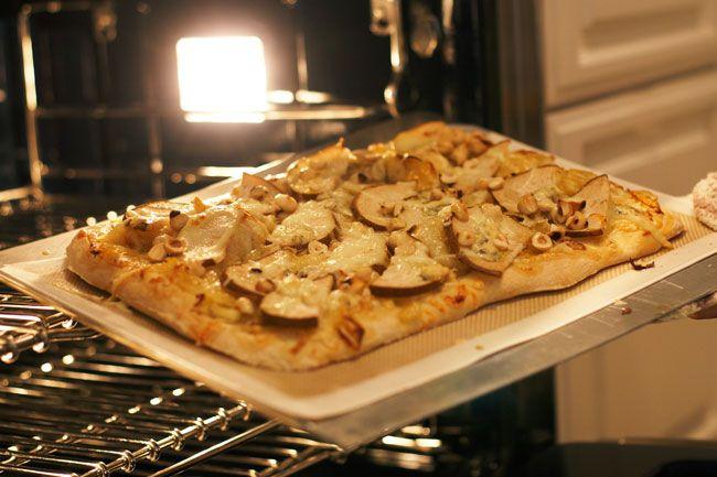 Pear, gorgonzola, caramelized onion, and arugala pizza. I'd add ...