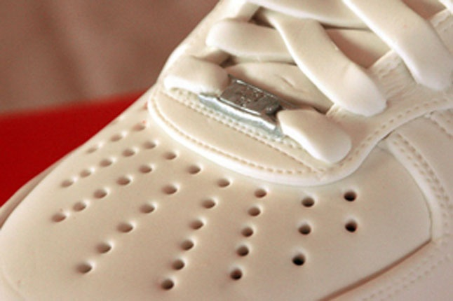 The perforated toe box on this Air Force 1 (White) cake looks detailed and delicious!
