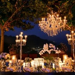 Chandeliers and Outdoor Weddings... a few dazzling ways to incorporate these glamorous accents into your outdoor nuptials. (pic via Fete NY)