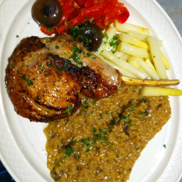 ... veal chop served with white asparagus and shiitake mushroom risotto