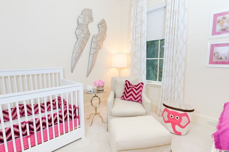 Modern White Nursery with Bright Pink Accents - especially love the angel wings!