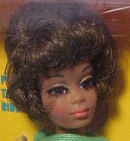 Talking Christie Doll was introduced in 1968.  Julia doll, using Christie's head/face mold, was introduced in 1969.