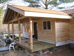 Adding a porch to a cabin addition screened porch deck for Log cabin additions ideas