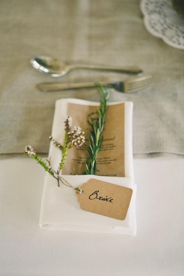 Sprigs of herbs table decor captured by Solas Photography