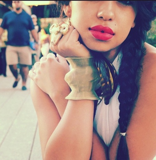 red lip and long braid
