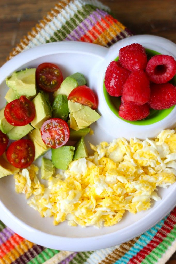 omelet with avocado, cherry tomatoes and raspberry