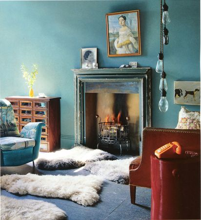 Blue walls and sheepskin rugs.