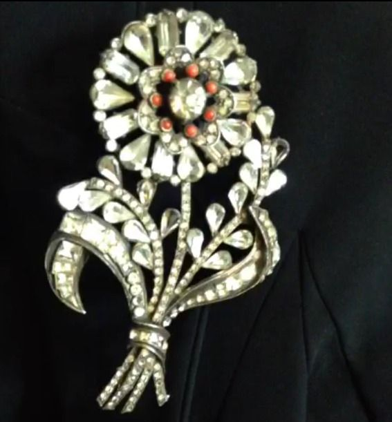 close up of one of dita von teese s brooches