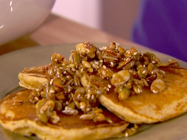 healthy breakfast: whole-wheat pancakes with nutty topping.
