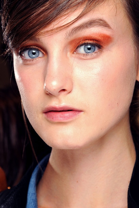 Chloe SS13: This makes a change for Chloe, there makeup has been minimal for a fair few seasons now. This look is all about colour and shape. A red and ornage hue are applied in elongated crescent above the eye. The elaborate eye makeup is complimented with pared down skin, lips and brows.