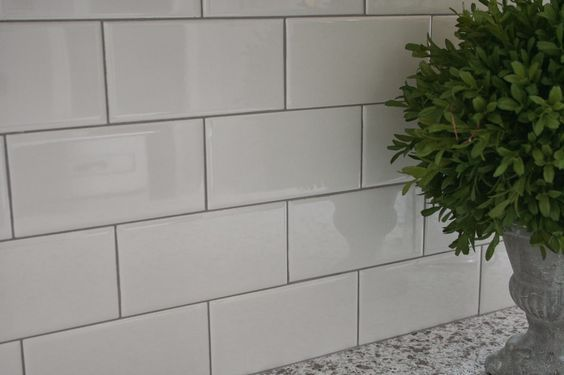 White tile backsplash with grey grout