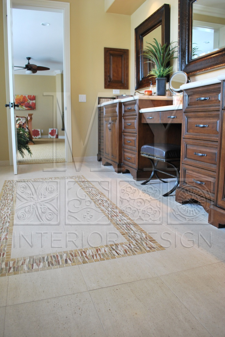 Amazing Tile Work Done On The Floor Of This Master Bathroom
