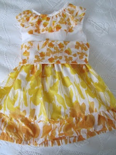 http://mama-says-sew.blogspot.com/2012/04/fields-of-flowers-dress.html#   This is where you can find the pattern for the dress! Too cute