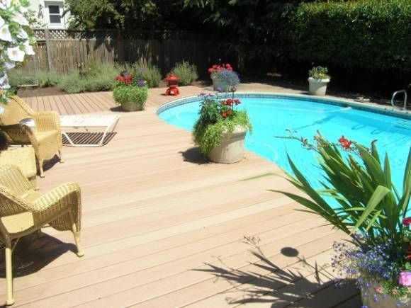 Composite deck around above ground pool for the home pinterest - Above ground composite pool deck ...