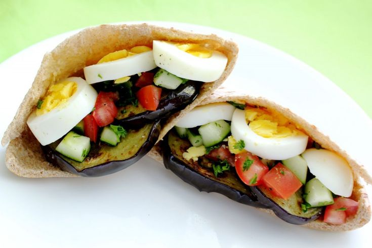Sabich (Iraqi jewish) sandwich with fried eggplant and boiled egg ...
