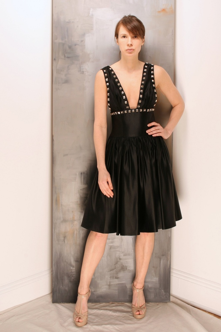 black, studs and decolletage.