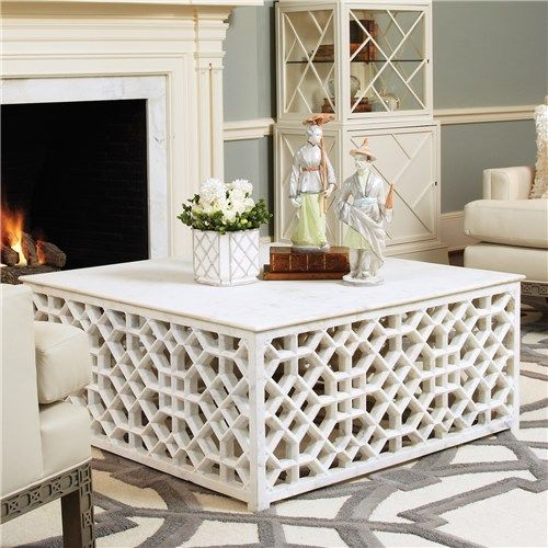 DIY project- Fancy lattice and a sheet of plywood on top....I think this would make an awesome coffee table maybe in red!