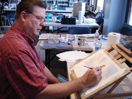 Artist Roland Lee demonstrates how to paint a snow scene in watercolor