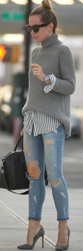 Top knot + turtleneck + distressed denim.