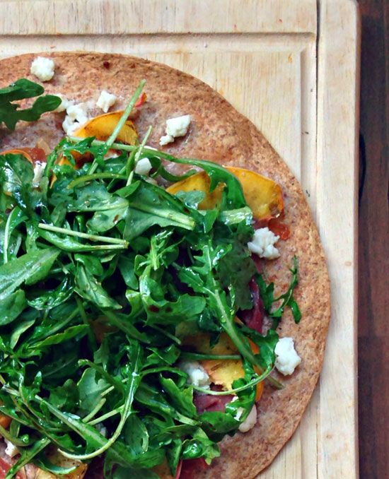 Grilled Peach Pizza with Prosciutto, Goat Cheese, and Arugula