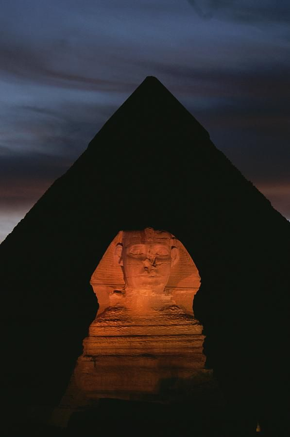 Equinox sunset at the Sphinx, with Menkaure's pyramid in background