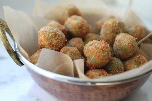 Brined, spicy, stuffed with cheese AND deep-fried. These olives ...