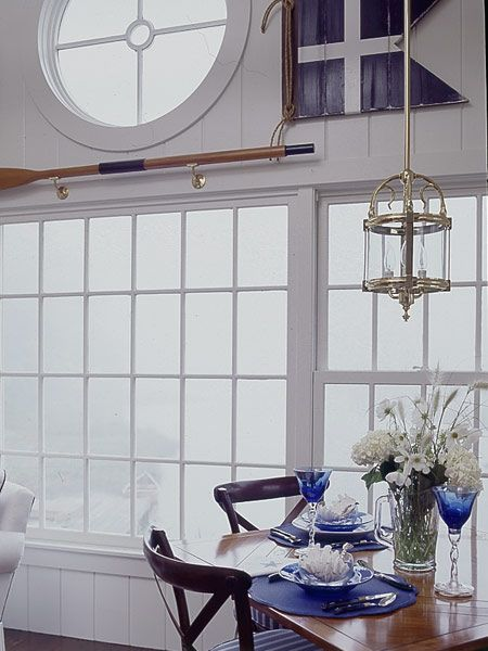 Perfectly classic nautical - has all of the right elements!  An oar, a fabulous chrome light pendant and a signal flag.  The round window is the crowning touch!