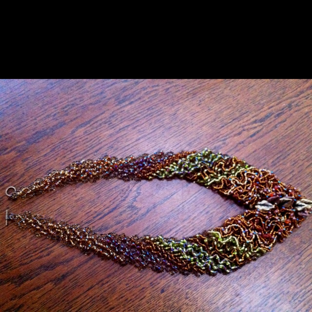 Latest beaded necklace finished in autumn-colours.