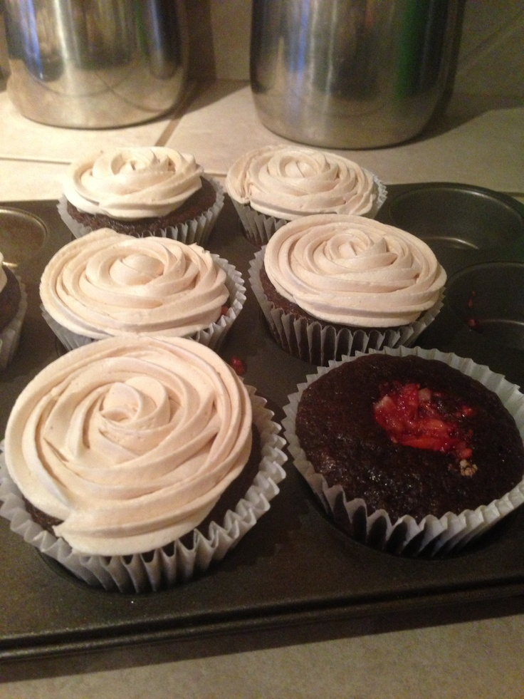 ... cupcakes. Chocolate cupcakes, raspberry filling, peanut butter mousse