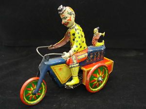 Clown on motorcycle wind-up toy