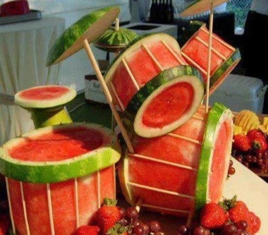 This Carved Watermelon Drum Set is amazing!  Feel free to play with your food.