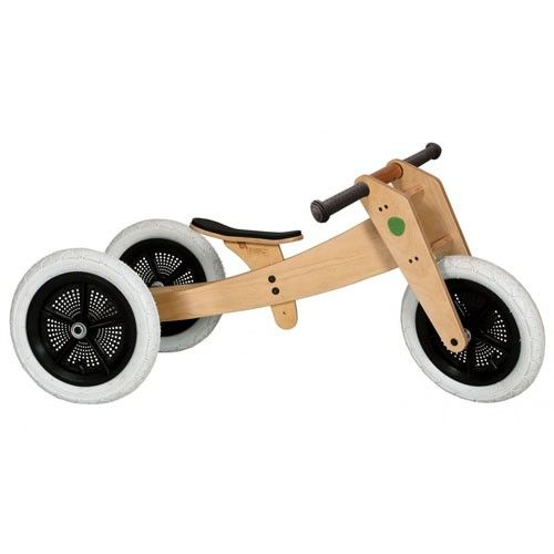 Wishbone Wooden Balance Bike converts from 3 wheels to 2 as a child grows.