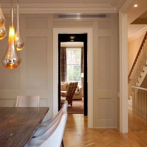 The dining room walls were paneled for architectural interest and painted Benjamin Moore's Revere Pewter. The table