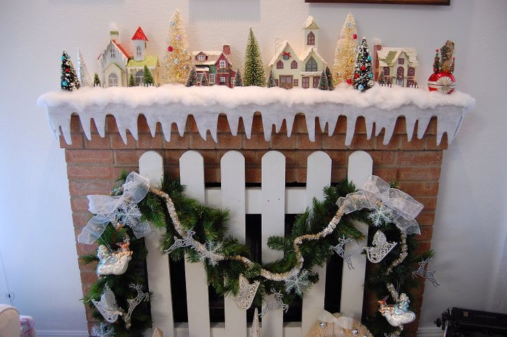 Christmas paper village houses on the mantel